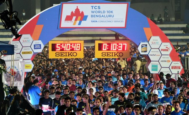 People participate in TCS world 10K Open run organised by Procam International Private Limited at Kanteerava Stadium in Bengaluru on Sunday.DH Photo