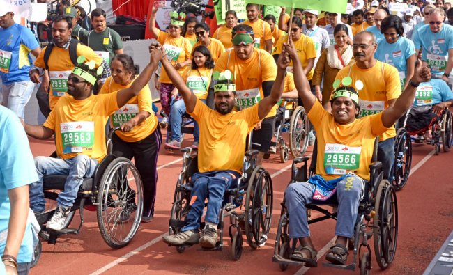 Physically challenged people participate in TCS world 10K run organised by Procam International Private Limited at Kanteerava Stadium in Bengaluru on Sunday.DH Photo