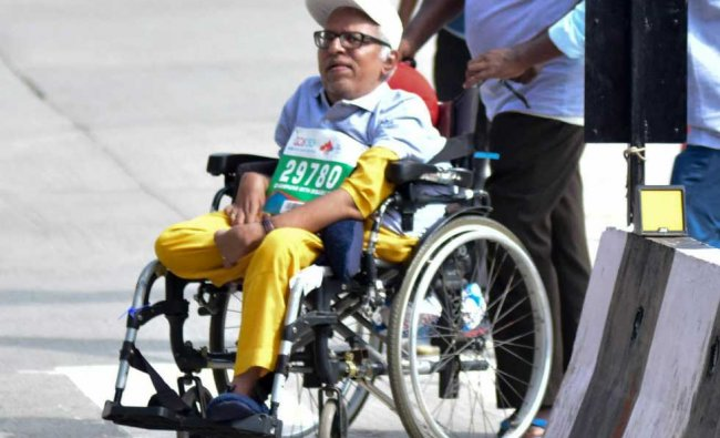 Physically challenged people participate in the TCS world 10K run held at Shree Kanteerava Stadium in Bengaluru on Sunday.DH Photo