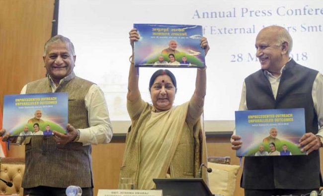 New Delhi: External Affairs Minister Sushma Swaraj (C), with Ministers of State MJ Akbar (R) and V K Singh, holds boxes which will contain books disseminating information on India, during the ministry\'s Annual Press Conference on completion of 4 years of the NDA government, in New Delhi on Monday, May 28, 2018. (PTI Photo)