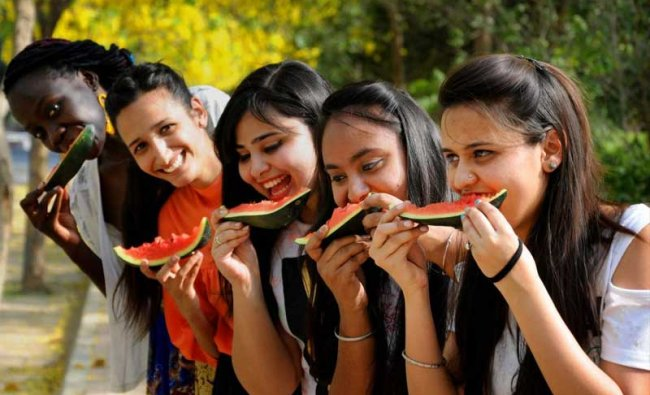 Young women pose while eating watermelons, on a hot summer day, in Amritsar, on Monday, May 28, 2018. ( PTI Photo)