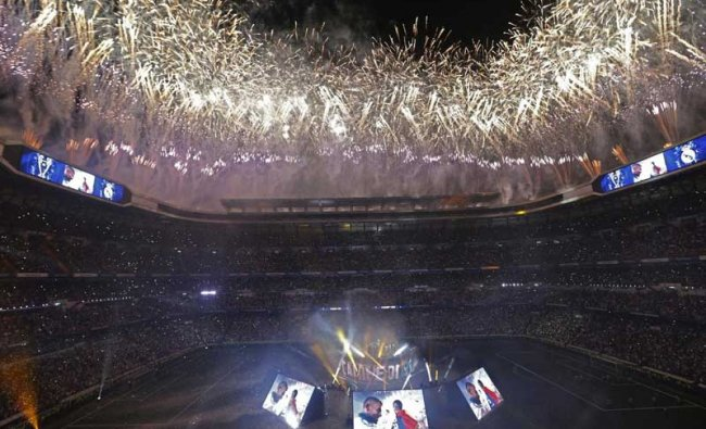 Madrid: Real Madrid supporters watch fireworks as the team celebrate after winning the Champions League final, at the Santiago Bernabeu stadium in Madrid, Spain, Sunday, May 27, 2018. AP/PTI