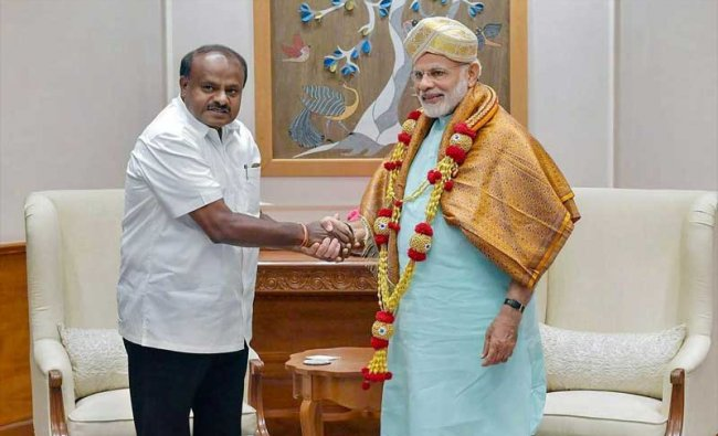 Karnataka Chief Minister HD Kumaraswamy meets Prime Minister Narendra Modi, in New Delhi on Monday, May 28, 2018. PTI Photo.