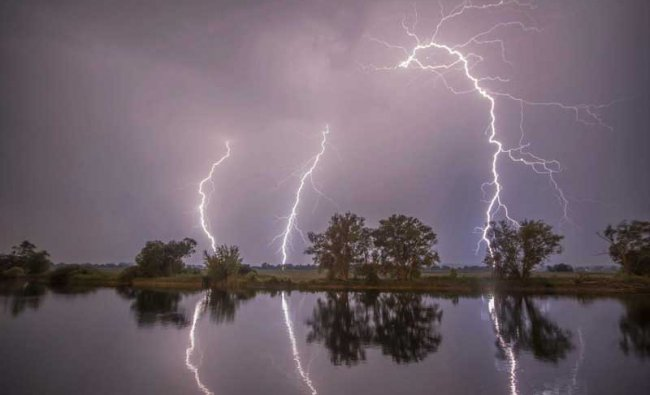 Premnitz: In this May 27, 2018 photo thunderbolts are reflected near Premnitz, eastern Germany. AP/PTI