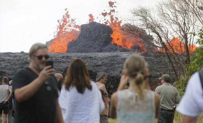 Pahoa: In a Saturday, May 26, 2018 photo, area residents, the media and national guard flock to what is now the end of Leilani Avenue to take in the fiery show at fissures 2, 7 and 8 of the Kilauea volcano near Pahoa. AP/PTI