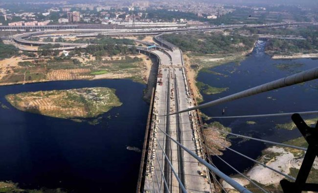 An aerial view of the Delhi\'s iconic Signature Bridge, in New Delhi, on Tuesday, May 29, 2018. Construction of the much-delayed bridge which was announced in 2004, the project was initially expected to be completed before the 2010 Commonwealth Games. The bridge had obtained environmental clearance in 2011 and was set to be completed by December 2013. The date of completing the project was pushed to June 2016 and then to July 2017, which was further pushed to December 2017 and now expected to complete in 201