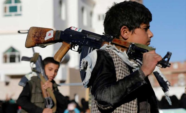 Boys carry rifles as they attend a gathering held by women loyal to the Houthi movement to show their support in Sanaa, Yemen January 14, 2018. REUTERS