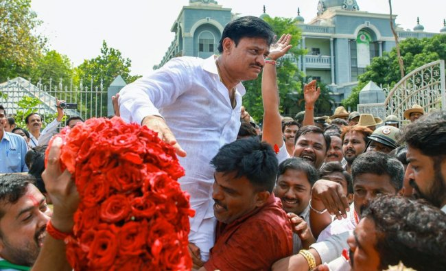 Bengaluru: Congress Party candidate Munirathna Naidu celebrates after winning from Rajarajeshwari Nagar constituency for Karnataka Assembly poll which was postponed to May 27, due to election-related malpractices, in Bengaluru on Thursday, May 31, 2018. (PTI Photo)