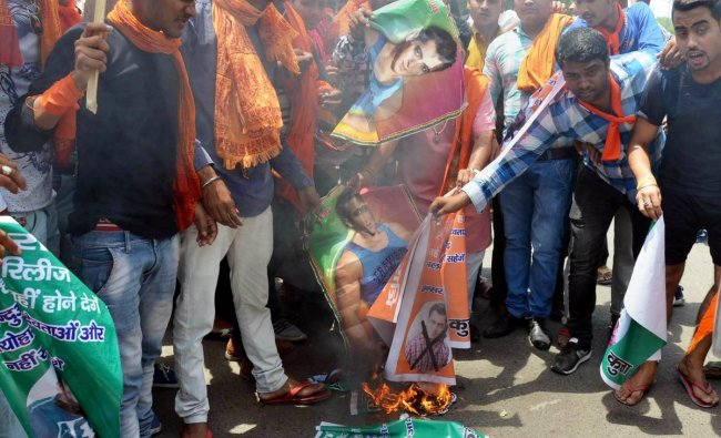 Agra: Members of Hindu Vahini Sangathan burn posters of actor Salman Khan during a protest against his upcoming movie \'Loveratri\', in Agra on Thursday, May 31, 2018. (PTI Photo)