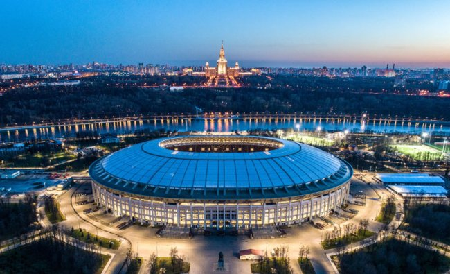 An aerial view taken with a drone shows the Luzhniki stadium and the main building of the Moscow State University in Moscow. Source: Dmitry SEREBRYAKOV / AFP