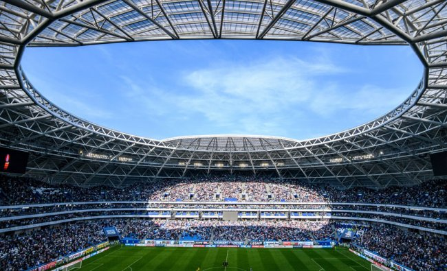 A general view shows the pitch of the Samara Arena, also known as Kosmos Arena, during a local match, in Samara, Russia, ahead of the 2018 World Cup. The nearly 45,000-seater stadium will host six World Cup matches. Source: Mladen ANTONOV / AFP