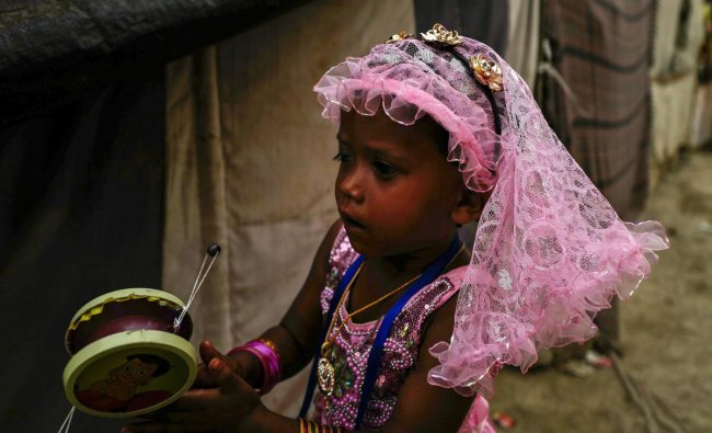 A Rohingya Muslim child during the Eid-ul-Fitr celebrations in a refugee camp at Kalindi kunj, in New Delhi. PTI Photo