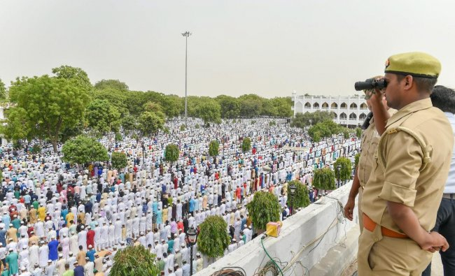 A policeman keeping a vigil at Lucknow Eidgah as muslims offer namaz on the occasion of Eid-ul-Fitr, in Lucknow on Saturday, June 16, 2018. PTI Photo