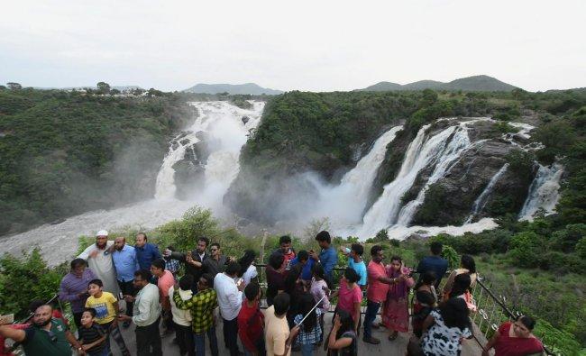 A group of tourists at Shivanasamudra Falls (Bluff) near Mysuru. PTI Photo