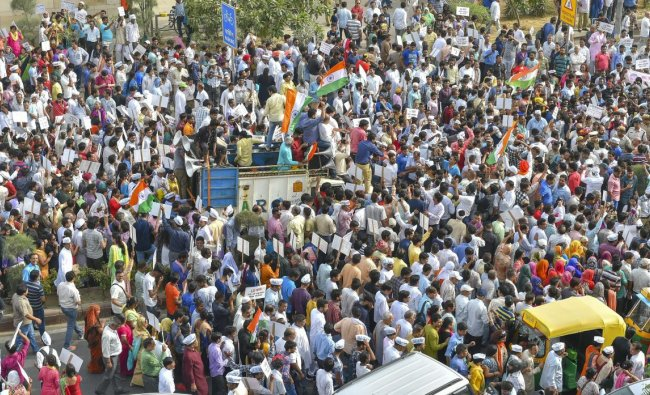 AAP workers march from Mandi House to Prime Minister\'s residence in support of Delhi Chief Minister Arvind Kejriwal\'s dharna at LG\'s office, in New Delhi. PTI Photo