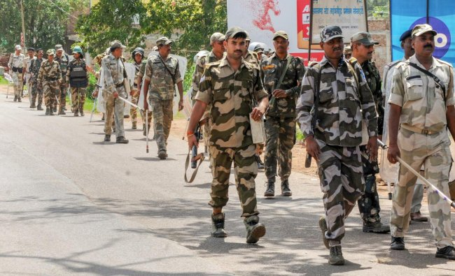 Police personnel patrol at Ranchi-Bedo road after clash between two groups, near Ranchi. PTI Photo