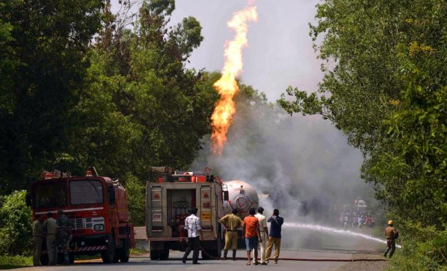 Firefighters douse the flames shooting up from an oil tanker which collided with a truck while carrying LPG, at Raipur in Birbhum district of West Bengal. PTI Photo