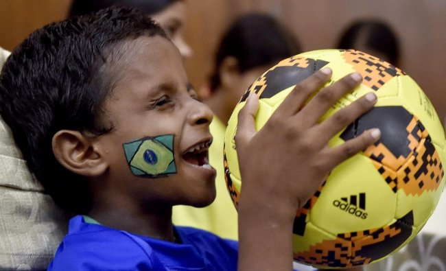 A visually impaired child plays with a football during the celebration of FIFA World Cup 2018, in Kolkata. PTI Photo
