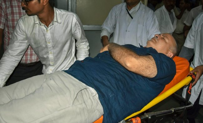 Deputy Chief Minister Manish Sisodia, who was on a hunger strike at Lt Governor\'s residence, being hospitalized at LNJP Hospital in New Delhi. PTI Photo
