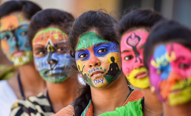 College students with painted faces look on during an event to commemorate International Day of Yoga 2018, in Chennai. PTI Photo