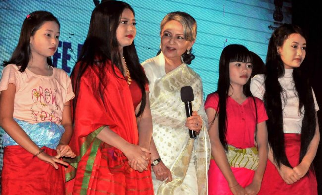 Veteran Bollywood actress Sharmila Tagore poses with young girls from Manipur during \'Kolkata International Children Theatre Festival 2018\', in Kolkata. PTI Photo