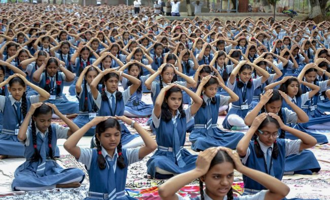 Students perform yoga on the occasion of 4th International Yoga Day, in Nashik. PTI Photo