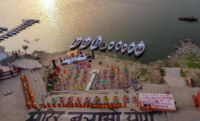 Pandits perform Yoga on International Yoga Day on the banks of River Ganga, in Varanasi. PTI Photo