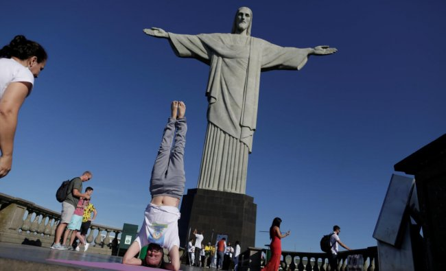People perform yoga on International Yoga Day in front of the statue of Christ the Redeemer in Rio de Janeiro. Reuters