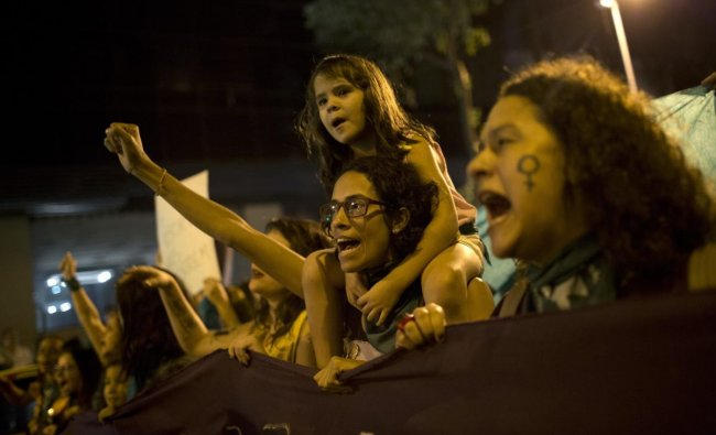 Women chant during a protest demanding the legalization of abortion without exception, in Rio de Janeiro, Brazil, Friday, June 22, 2018. Abortion is illegal in Brazil, except when a woman\'s life is at risk, when she has been raped or when the fetus has a usually fatal brain abnormality called anencephaly. AP/PTI