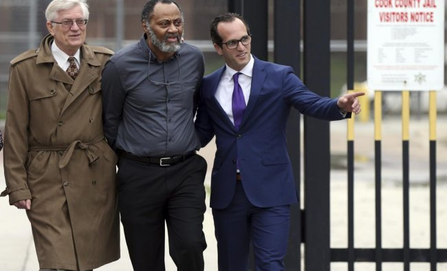 Flanked by his attorneys G. Flint Taylor, left, and Elliot Slosar, right, Jackie Wilson, center, leaves the Cook County Jail in Chicago on Friday, June 22, 2018, after a judge issued a finding that had detectives physically coerced Wilson\'s confession to the 1982 slaying of two Chicago officers. AP/PTI