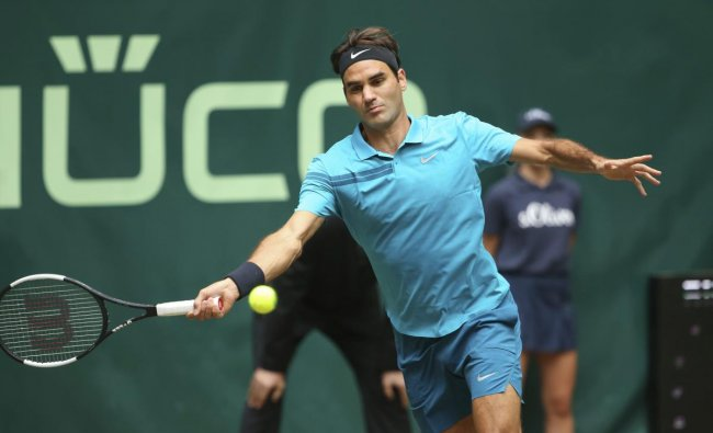 Roger Federer returns the ball to Denis Kudla during their semi final match at the Gerry Weber Open ATP tennis tournament in Halle, Germany, Saturday, June 23, 2018. AP/PTI