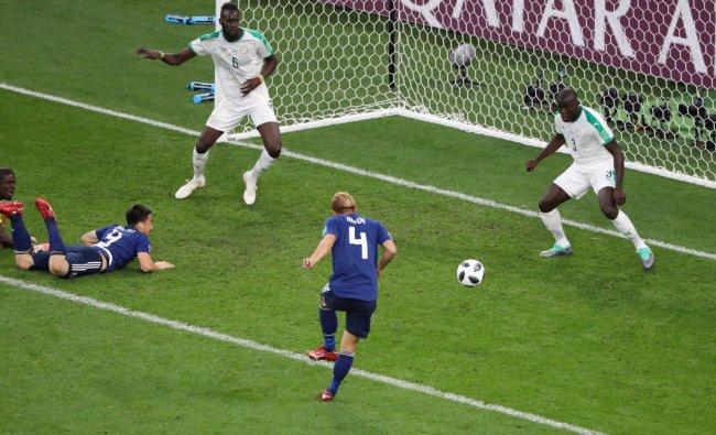 Soccer Football - World Cup - Group H - Japan vs Senegal - Ekaterinburg Arena, Yekaterinburg, Russia - June 24, 2018 Japan\'s Keisuke Honda scores a goal REUTERS