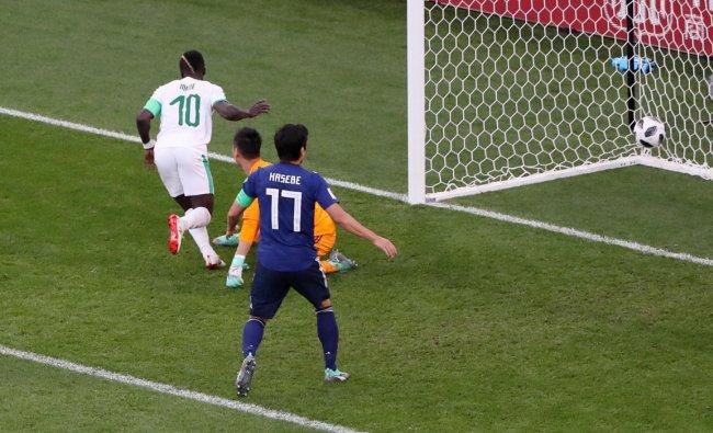 Soccer Football - World Cup - Group H - Japan vs Senegal - Ekaterinburg Arena, Yekaterinburg, Russia - June 24, 2018 Senegal\'s Sadio Mane scores their first goal past Japan\'s Eiji Kawashima REUTERS