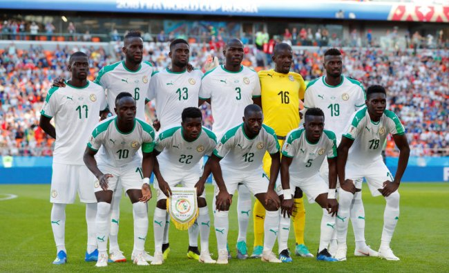 Soccer Football - World Cup - Group H - Japan vs Senegal - Ekaterinburg Arena, Yekaterinburg, Russia - June 24, 2018 Senegal players pose for a team group photo before the match REUTERS