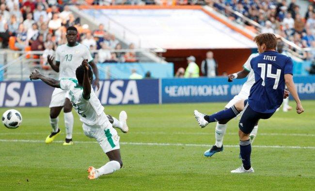 Soccer Football - World Cup - Group H - Japan vs Senegal - Ekaterinburg Arena, Yekaterinburg, Russia - June 24, 2018 Japan\'s Takashi Inui scores their first goal REUTERS