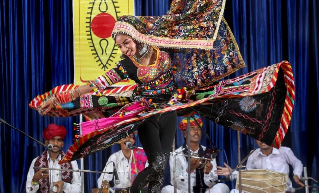 Rajasthani artists perform \'Kalbeliya\' dance during an event conducted by Spic Macay, in Kozhikode on Monday, June 25, 2018. PTI