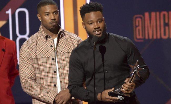 Michael B. Jordan, left, and Ryan Coogler accept the best movie award for \