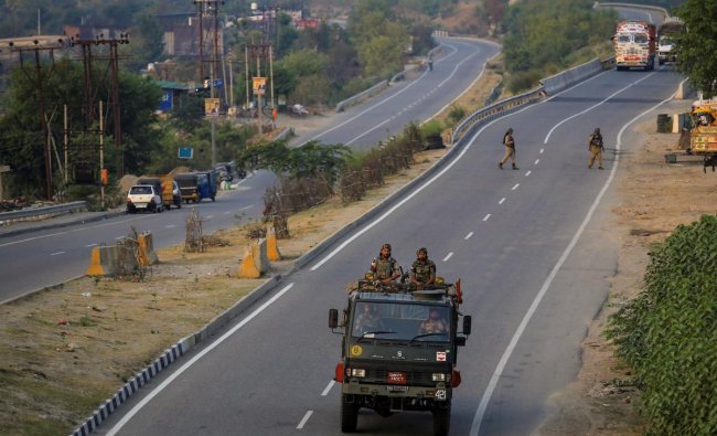 Security personnel keep vigil near Jammu-Srinagar National Highway ahead of the annual Amarnath Yatra, which commences tomorrow, in Jammu on Tuesday, June 26, 2018. PTI