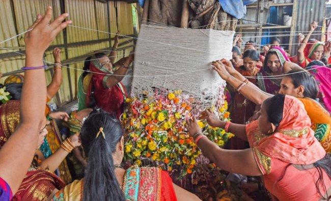 Married women perform rituals as they celebrate Vat Purnima, in Mumbai on Wednesday, June 27, 2018. PTI