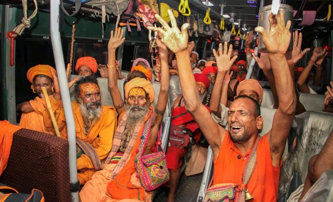 Sadhus shout religious slogans in a bus, as the first batch of pilgrims leaves for Amarnath Yatra, in Jammu on Wednesday, June 27, 2018. PTI