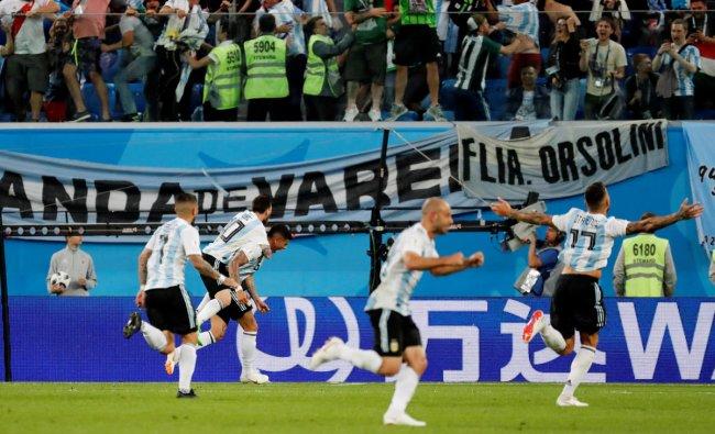 World Cup - Group D - Nigeria vs Argentina - Saint Petersburg Stadium, Saint Petersburg, Russia - June 26, 2018 Argentina\'s Marcos Rojo celebrates scoring their second goal with Lionel Messi and team mates. Reuters