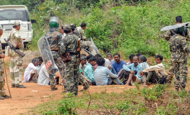 Security personnel detain villagers while carrying out a search operation at the remote village Ghagra, where Member of Parliament (MP) Karia Munda\'s three bodyguards, belonging to Jharkhand Police, were allegedly kidnapped by Pathalgarhi supporters, in Khunti district on Wednesday, June 27, 2018. PTI
