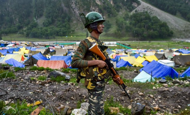CRPF personnel stands guard near Amarnath base camp at Baltal, in Ganderbal district of central Kashmir on Thursday, June 28, 2018. The annual two-month Amarnath Yatra to commence on Thursday was halted dur to bad weather and heavy rainfall. PTI