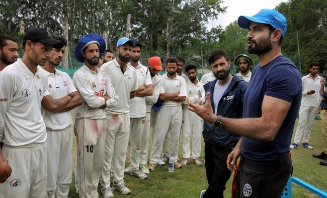 Indian cricketers Irfan Pathan and Parvez Rasool interact with aspiring cricketers during a special training session for Kashmiri youth, in Srinagar on Thursday, June 28, 2018. PTI