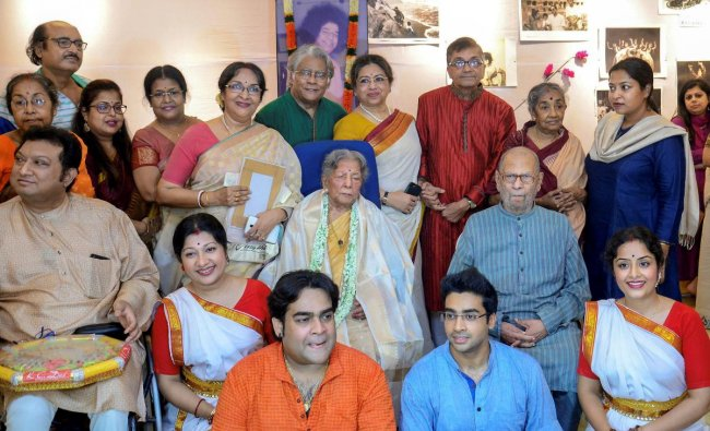 Eminent dancer and choreographer Amala Shankar with her family members as they celebrate her 100th birthday at her residence, in Kolkata on Wednesday night, June 27, 2018. PTI