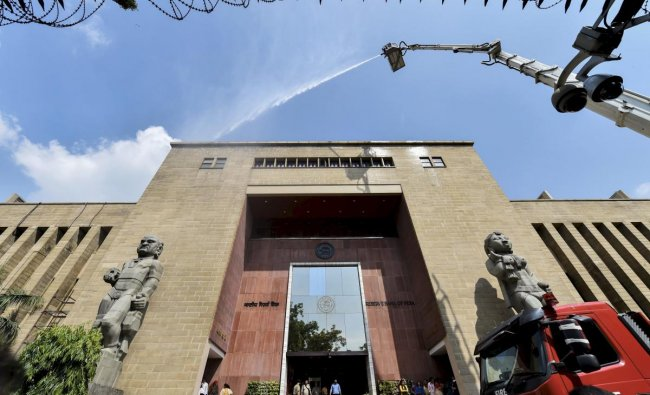 Firemen pour water through a sky lift during a mock drill at Reserve Bank of India (RBI) building in New Delhi, on Thursday, June 28, 2018. PTI