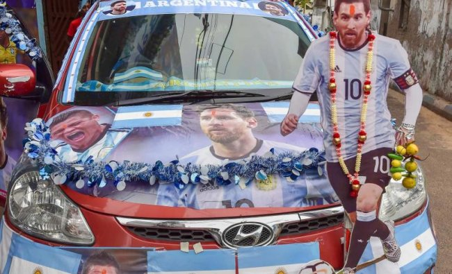 Argentina fans cheer with the posters of the country\'s football team players, ahead of Argentina vs France match at FIFA World cup 2018, in Kolkata on Saturday, June 30, 2018. (PTI Photo)