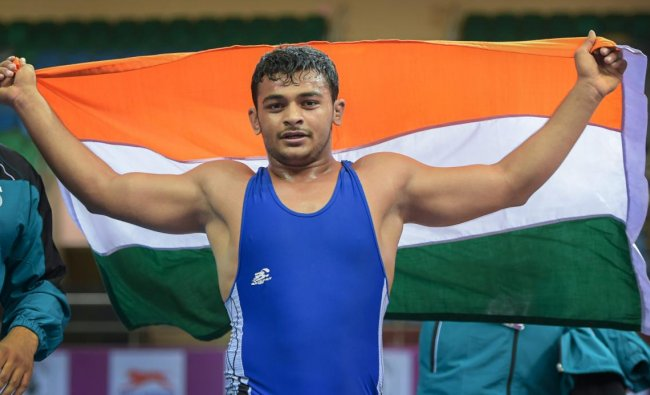 Wrestler Deepak Punia celebrates after winning gold in the Free Style (86kg category) during the 2018 Junior Asian Wrestling Championship, in New Delhi. (PTI Photo)