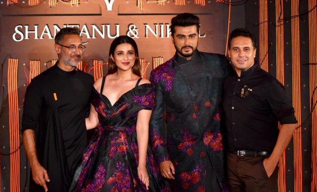 Parineeti Chopra and Arjun Kapoor with designers Nikhil and Shantanu during a fashion show in New Delhi. (PTI Photo)