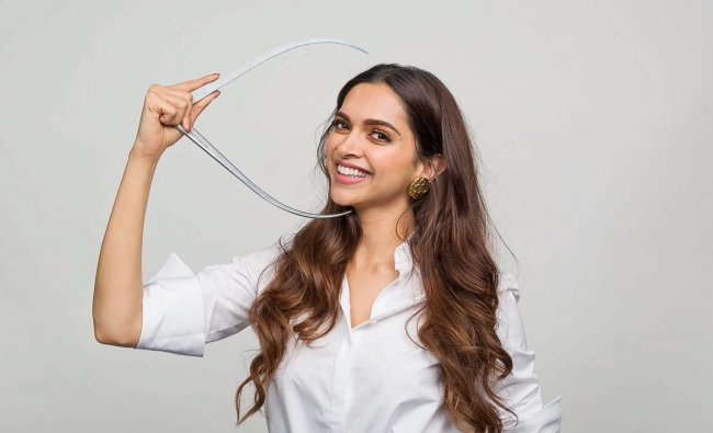 Deepika Padukone gives measurements for a wax statue to be displayed at Madame Tussauds, in Mumbai. (PTI Photo)